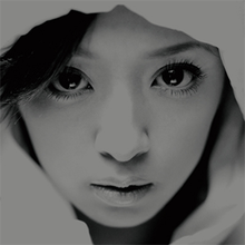 A black-and-white up-close shot of Ayumi Hamasaki's face looking into the camera.