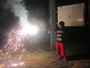 Kali Puja - A child bursting firecracker in Bengal during Kali Puja