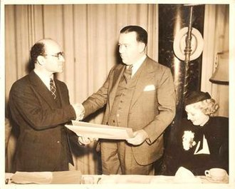 Cliff Reid - Reid (on the left) receiving the Association of Foreign Correspondents of Hollywood award for Best Picture for 1935's The Informer