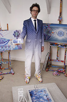 Dadara in his studio with works from the Exchanghibition Bank project, 2011.