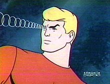 Aquaman is shown concentrating and looking over his right shoulder. Concentric rings are shown coming from his forehead as a special effect related to his telepathic control of fish.