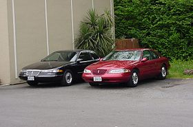 a 1994 lincoln mark viii (black) and a 1997 lincoln mark viii lsc (toreador  red): these represent the first and second generations of the fn10  platform,