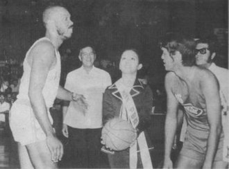 Philippine Basketball Association - Ms. PBA, Mia Montemayor tosses the ceremonial ball between Mariwasa's Cisco Oliver and Concepcion's Ramon Lucindo during the opening ceremonies of the Philippine Basketball Association on April 9, 1975. Looking on are PBA commissioner Leo Prieto and PBA president Emerson Coseteng.