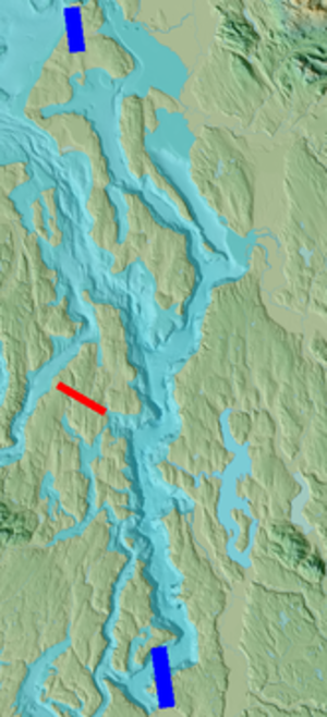Olympic-Wallowa Lineament - The west side of central Puget Sound, Holmes Harbor, and Saratoga Passage forms a lineament (between blue bars) that is offset at Port Madison (red bar).