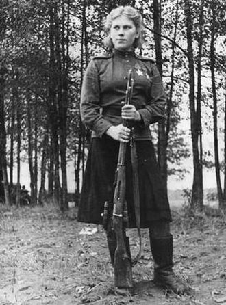 Roza Shanina - Shanina in November 1944, wearing a male-issue wool field shirt and woollen skirt. The shirt was khaki, while the skirt was dark blue.
