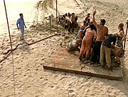 Tribes compete frequently in both mental and physical challenges to win rewards or immunity, such as this race to pull cannons during the first episode of Survivor: Pearl Islands.