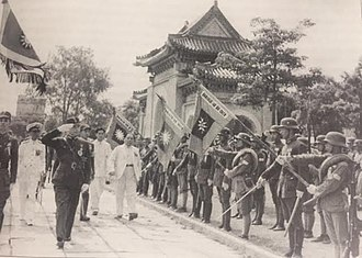 Collaborationist Chinese Army - Wang Jingwei inspecting an honor guard during a parade, 1942