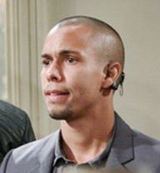 Devon Hamilton - Bryton James (above) as Devon wearing his cochlear implant in 2012.