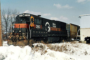 GE U23B - MEC 280, originally built as DH 301, was the first U23B built by GE in 1968. It is seen here working in Ayer, MA, in February 1993