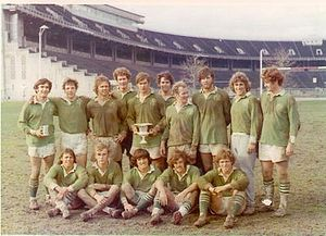 Notre Dame Rugby Football Club - 1973 - The Notre Dame Rugby team wearing green jerseys with the shamrock logo reclaiming the Silver Cup from Ohio State.