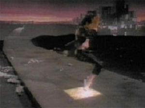 "Billie Jean - Jackson landing on his toes and illuminating a tile in the music video for ""Billie Jean""."