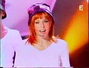 """C'est une belle journée - Mylène Farmer performing """"C'est une belle journée"""" on Zinedine Ela show."""