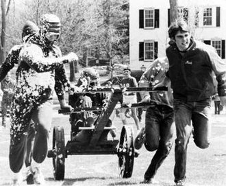Dartmouth College traditions - Students racing chariots on the Green at Green Key Weekend.