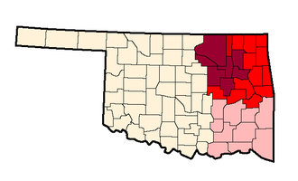 Green Country - Possible definitions of Green Country. The borders as officially defined by the Oklahoma Department of Transportation denoted by shades of darker reds; The counties of the Tulsa Metropolitan Area denoted in darkest red; possible inclusion of Southeastern Oklahoma in pink, although the Oklahoma Department of Tourism includes this area in the separate Choctaw Country.