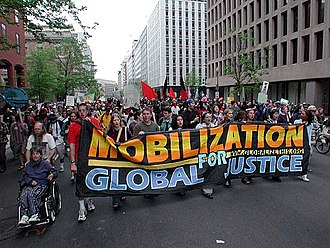Global justice movement - Activists protest policies of the World Bank in Washington, DC.