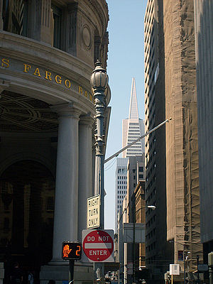 Montgomery Street - Looking north from Market Street up Montgomery Street towards the Transamerica Pyramid. In the foreground is the flagship branch of Wells Fargo Bank.