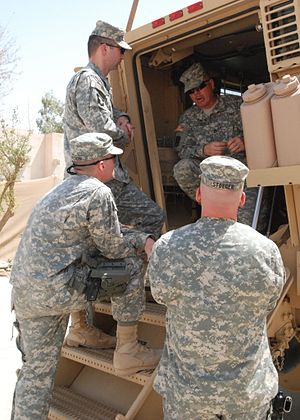 1st Sustainment Brigade (United States) - A 1st Sustainment Brigade soldier briefs 10th Sustainment Brigade soldiers on the MRAP in Iraq.