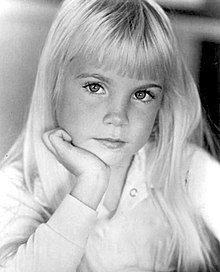 Young female child with blonde hair posed