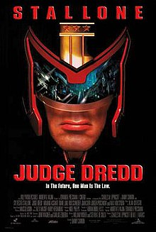 A headshot picture of Judge Dredd, wearing his helmet and with a view of Mega City One inside his glasses of the helmet. Below him there are the film's slogan, title, credits and release date.