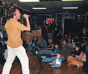 James Kochalka - James Kochalka performs in August 2004 at the Crow Bookshop in Burlington, Vermont.