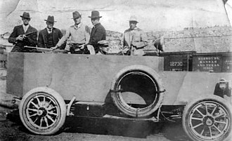 "Ludlow Massacre - Baldwin–Felts armored car known as the ""Death Special"" with mounted M1895 machine gun."