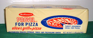Pizza cheese - Provel pizza cheese in a five-pound block. This product is commonly used in the preparation of St. Louis-style pizza.