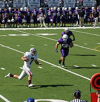 2007 Trinity vs. Millsaps football game - Trinity WR Riley Curry pursued by LB Shawn Gillenwater of Millsaps.