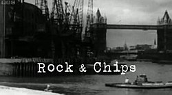 "The text ""Rock & Chips"" in a fixed-width, typewriter-style white font overlaid on a black-and-white construction scene beside the River Thames"