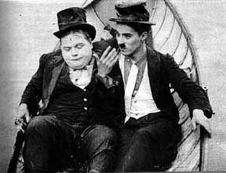 The Rounders (1914 film) - Chaplin and Arbuckle in the final scene.