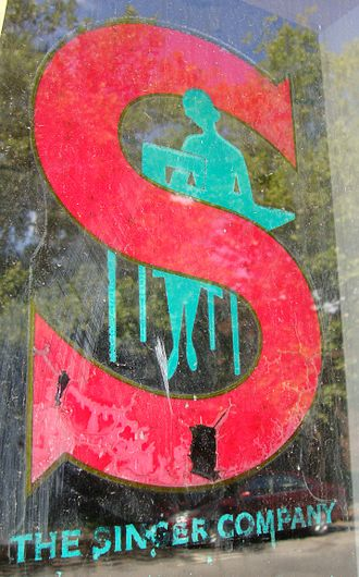 Singer Corporation - Painted Singer Sewing sign in Kingston, NY