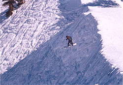 Snowboarder trail entry