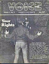 "A picture of the black-and-white cover of the May 1977 issue of ""The Voice"". The word ""Voice"" is printed in bubble letters at the top of the cover. The cover picture is of a male with his hands extended away from his body as a police officer interacts with him. The cover story's title, ""Your Rights"", is located on the picture's left-hand side."