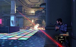 Alpha Protocol - In this gameplay screenshot, Michael Thorton is hiding behind a cover in the midst of a boss fight.