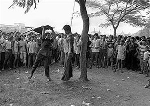 Thammasat University massacre - Image: Beating corpse with a chair, 6 October 1976