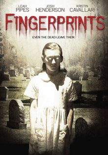 The DVD cover shows a zombie like older girl in a white short sleeve dress looking down in a graveyard, the movie title is written in blood that is leaking down