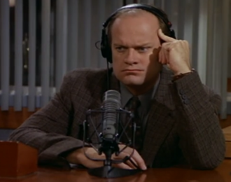 "Frasier Crane - Dr. Frasier Crane doing his radio show at KACL in the Frasier episode ""Shrink Wrap"" (episode 50, 1995)"
