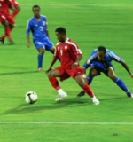 Omani footballer, Hashim Saleh in action for his team, Dhofar F.C. facing city rivals, Al-Nasr F.C