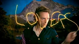 "Lovers in Japan - Chris Martin light painting the word ""Lovers"" in the music video."