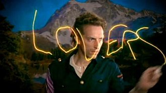 """Lovers in Japan - Chris Martin light painting the word """"Lovers"""" in the music video."""