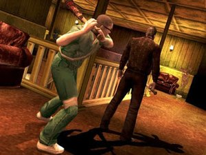 Manhunt 2 - Stealth in Manhunt 2; Daniel Lamb, attempting to execute an enemy guard with a baseball bat.