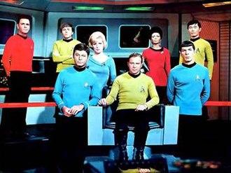 Star Trek: The Original Series - Promotional photo of the cast of Star Trek during the third season (1968–1969). From left to right: James Doohan, Walter Koenig, DeForest Kelley, Majel Barrett, William Shatner, Nichelle Nichols, Leonard Nimoy, and George Takei.