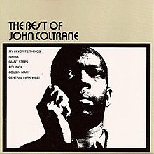 A photograph of John Coltrane's torso, holding his right hand up to his head with a thick black border and the album and song titles around him