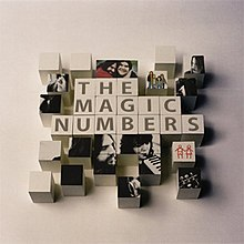 "The phrase ""The Magic Numbers"" spelled out with children's toy blocks"