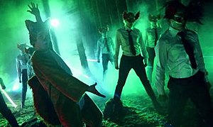The Fox (What Does the Fox Say?) - Vegard Ylvisåker (left) in animal costume in the music video