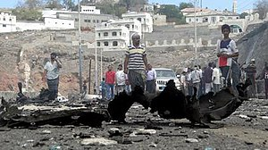 Aden unrest (2015–present) - People gather at the site of a car bomb attack that killed the Aden governor, Jaafar Mohammed Saad, during the Aden unrest.