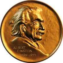 Obverse of a golden medal with the image of Albert Einstein facing right, the name Albert Einstein at the lower left and the dates 1835-1955 below the name.