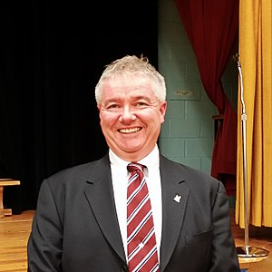 Councillor Paul Ainslie at a community meeting.jpg