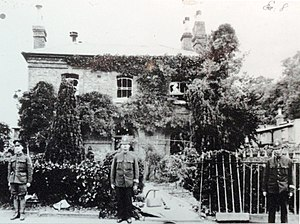 Epsom Riot - Police Officers guard Epsom Police Station after the riot