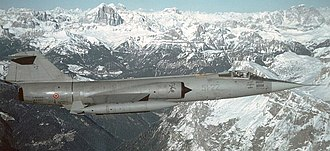 Aeritalia F-104S Starfighter - F-104S ASA in low-visibility colour scheme flying over the Alps