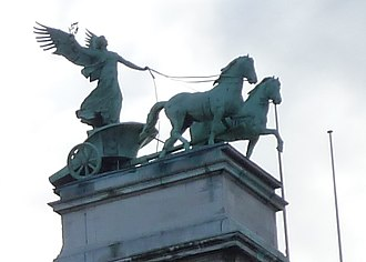 Thomas Vinçotte - Fame with chariot, atop the Royal Museum of Fine Arts, Antwerp